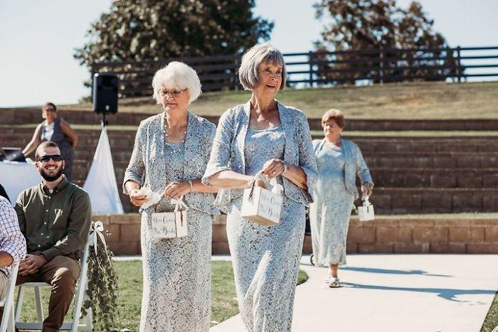 bride has her 4 grandmas as flower girls in wedding