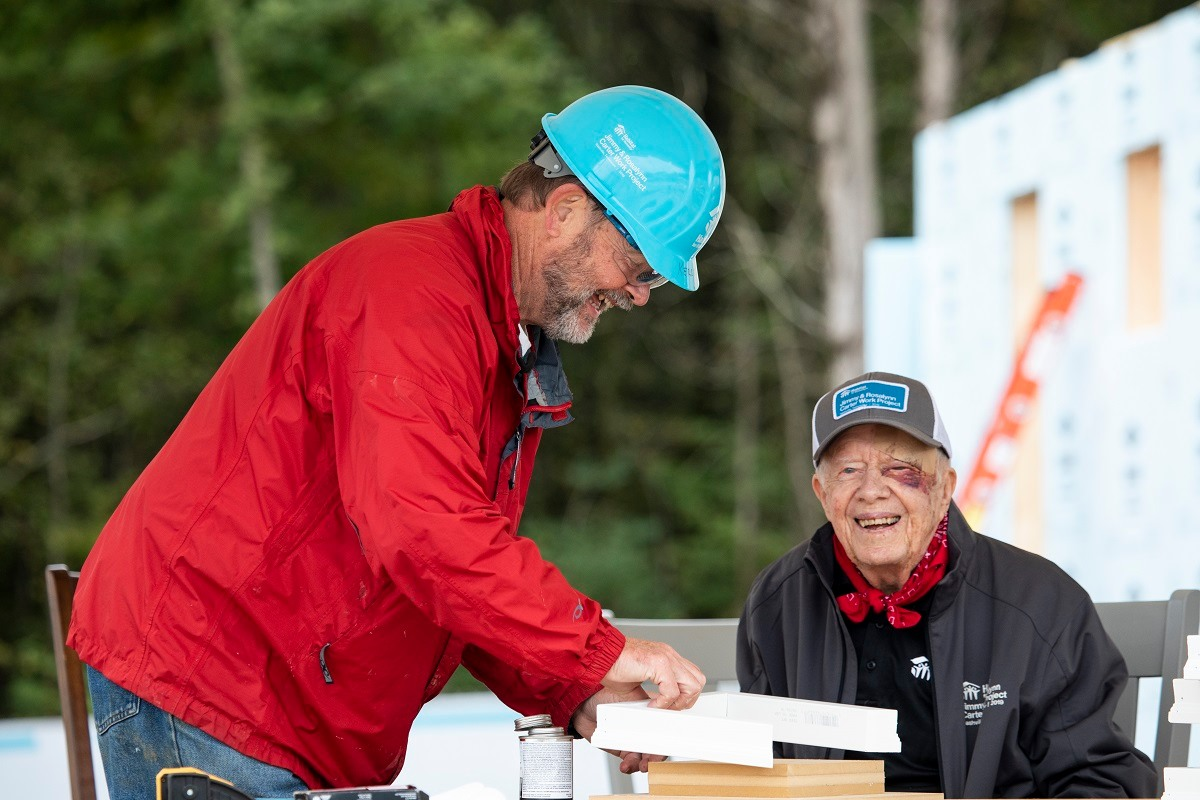 jimmy carter builds homes with black eye and stitches