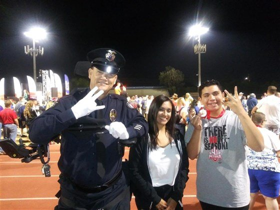 paralyzed police officer able to stand for national anthem