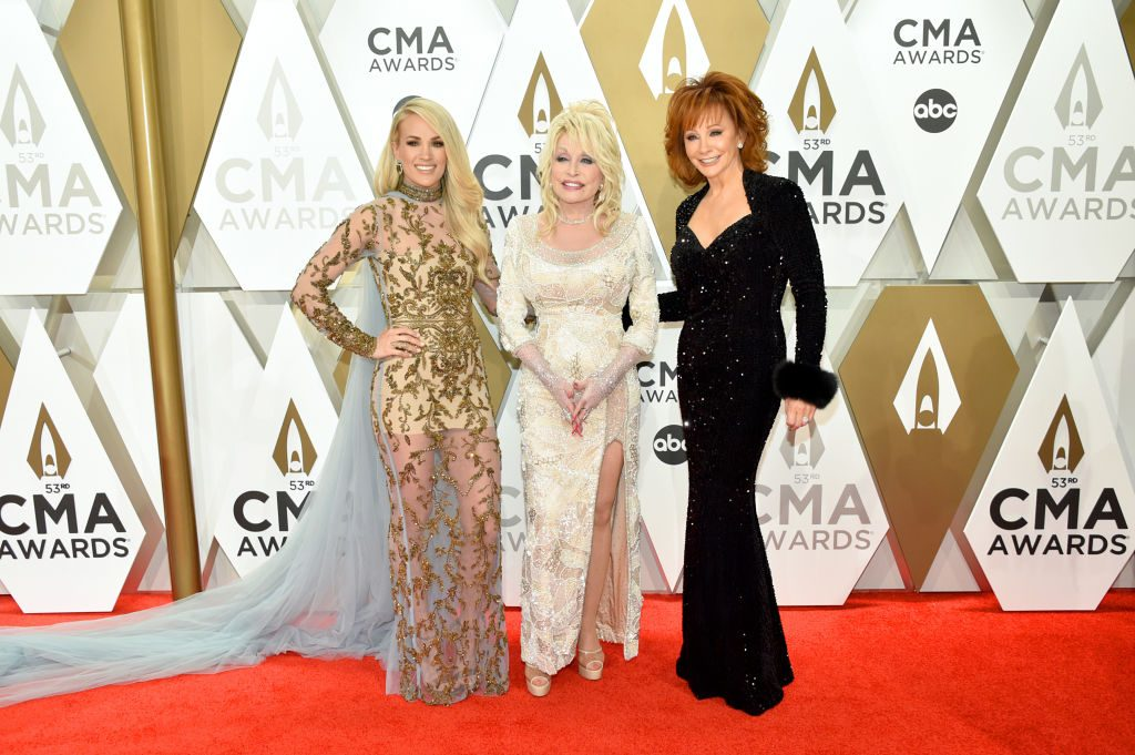 Carrie Underwood, Dolly Parton and Reba McEntire posing on the red carpet at the 53rd annual CMA Awards at the Music City Center on November 13, 2019 in Nashville, Tennessee.