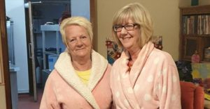 Employees at the Old Vicarage Nursing Home wear pajamas to help seniors relax