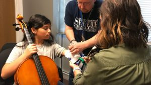 Kayla Arqueta is fitted for her prosthetic, a joint effort between students at Nimitz High School, their instructor, the orchestra teacher, and the Irving Schools Foundation