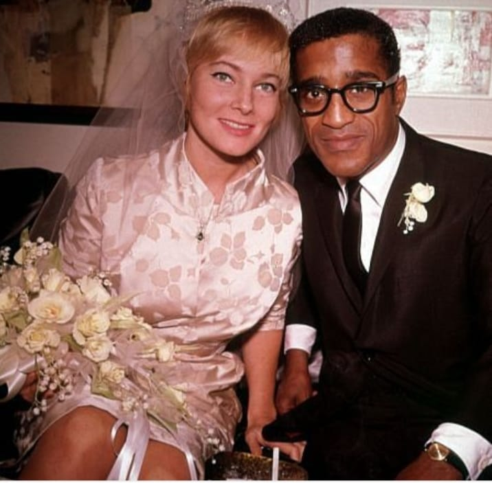 Sammy Davis Jr. marrying his bride, May Britt.