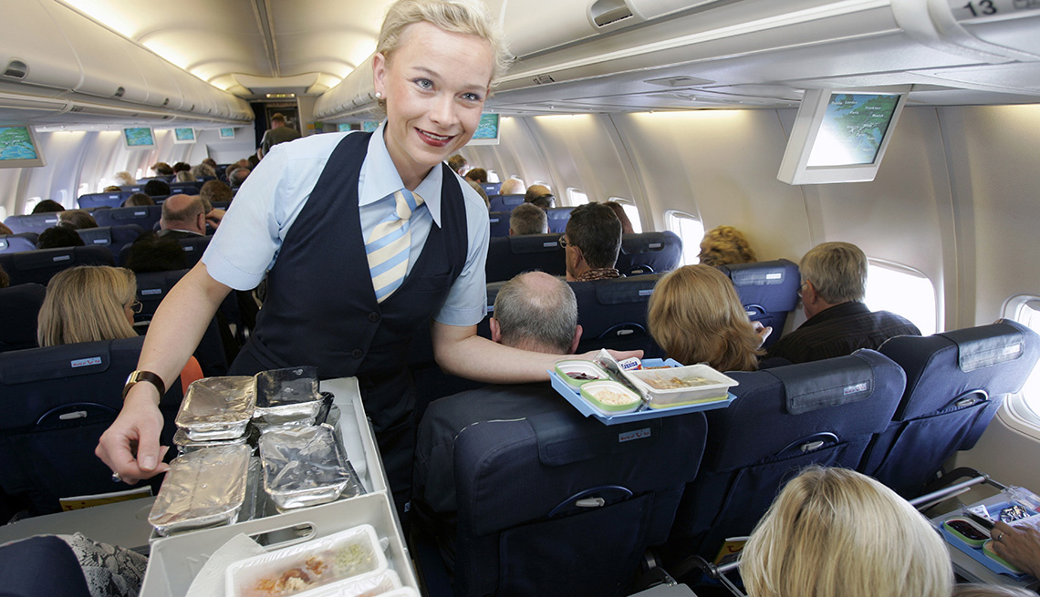 Plane Passenger Perches Bare Feet On Headrest Of Person In Front Of Her