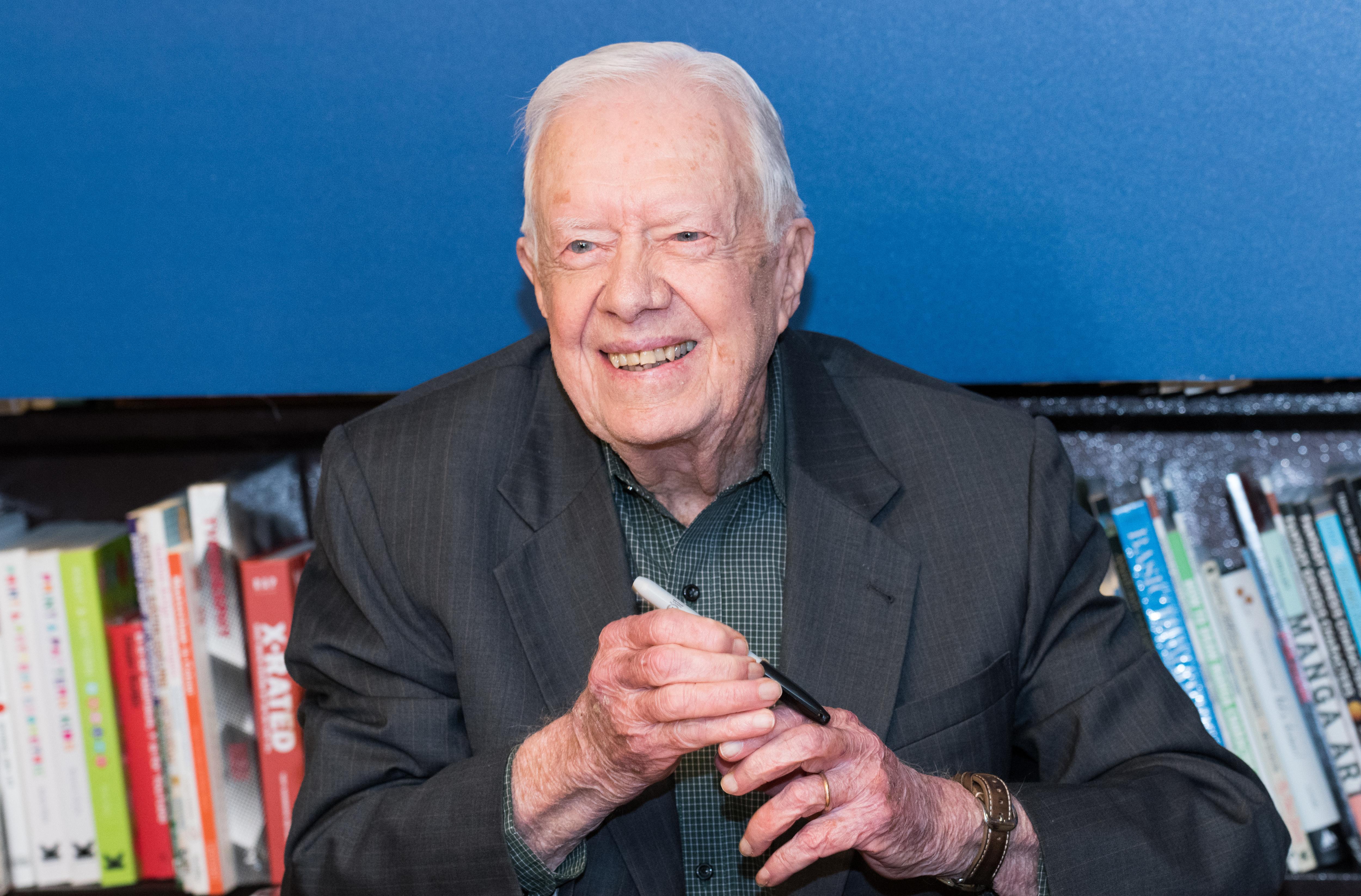 former president jimmy carter signing books