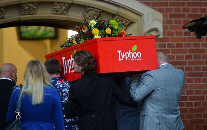 woman buried in a giant tea bag box