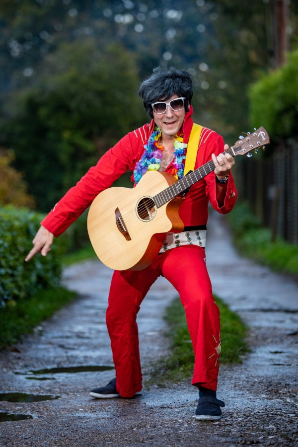elvis impersonator not let on stage