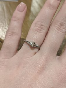 Emily T. prefers small engagement rings because of her job