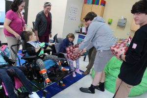 Students handed out switch adapted toys they adjusted for easier play