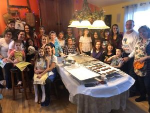 Volunteers and friends come together to bake cookies for the troops