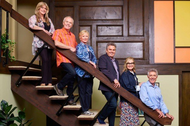 the brady bunch siblings on the stairs