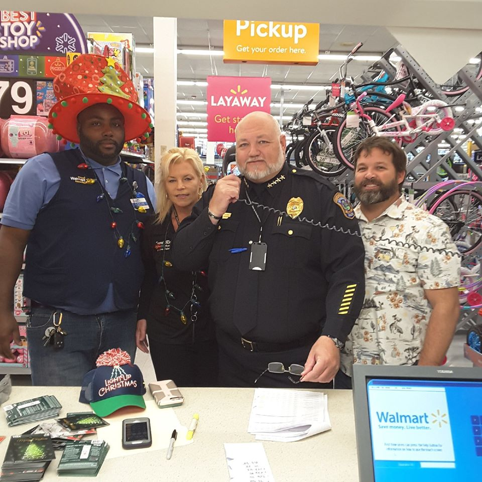 police officers paying off layaway accounts at walmart
