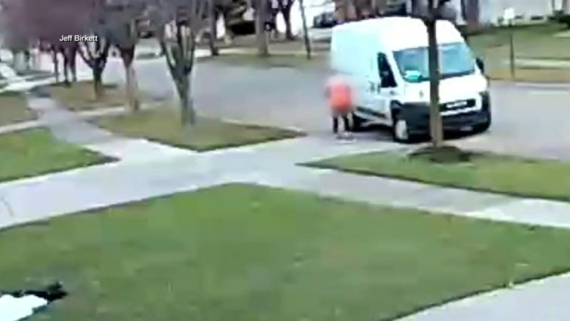 delivery driver runs over amazon package 3 times