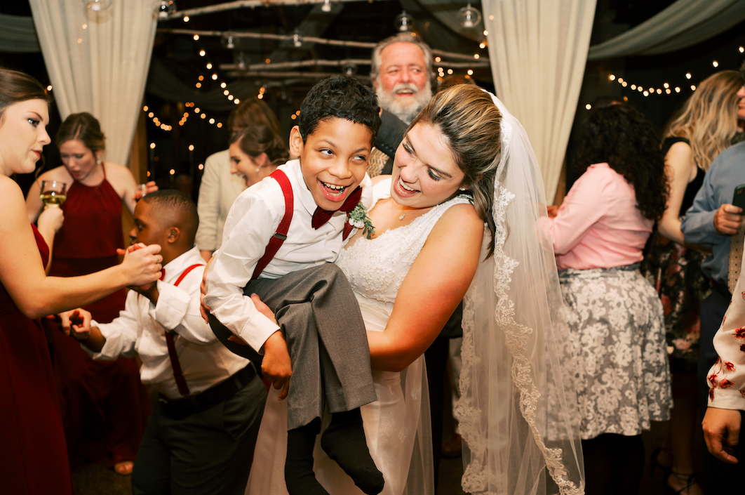 students with disabilities walk teacher down the aisle at her wedding