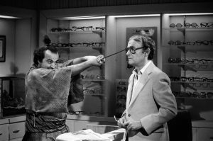 Henry appeared with John Belushi on SNL for the 1978 Samurai Optometrist sketch