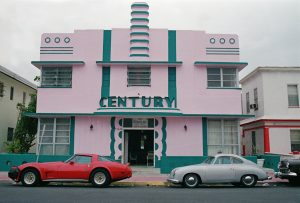 The iconic Century Hotel stands with unique paint details and cars of the era