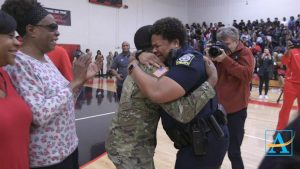 U.S. Army Spc. Shakir Aquil and Officer L.J. Williamson exchanged their first heartfelt hug in two years when he was last in America