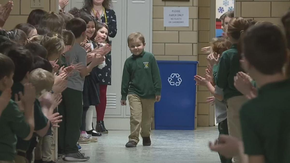6 year old boy gets standing ovation from classmates after beating cancer