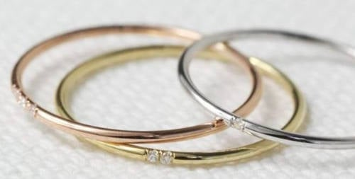 Women Mock Bride's Tiny Engagement Ring, Comparing It To A Keyring