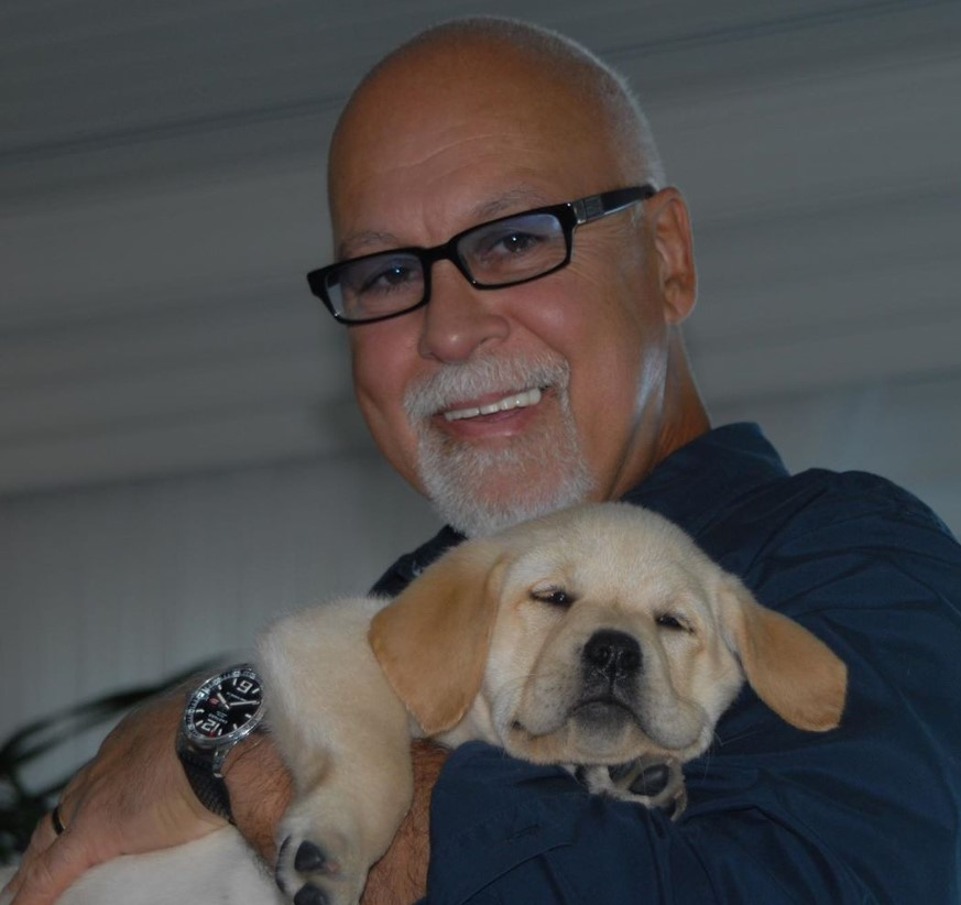 celine dion late husband René Angélil holding puppy