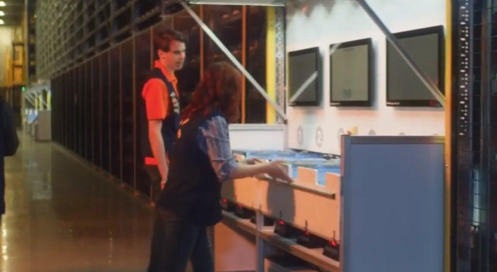 walmart employees working with alphabot