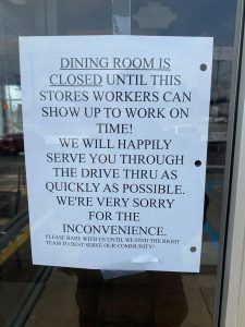 Taco Bell management closed the dining area and posted a sign calling out employees who arrived late