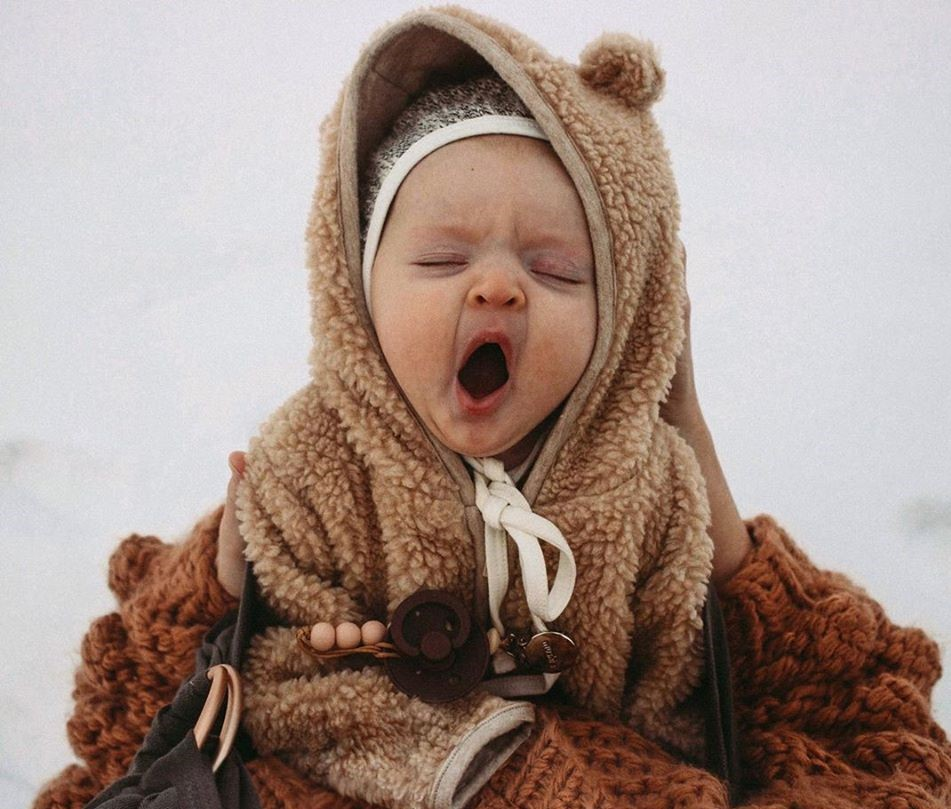 baby in a bear outfit