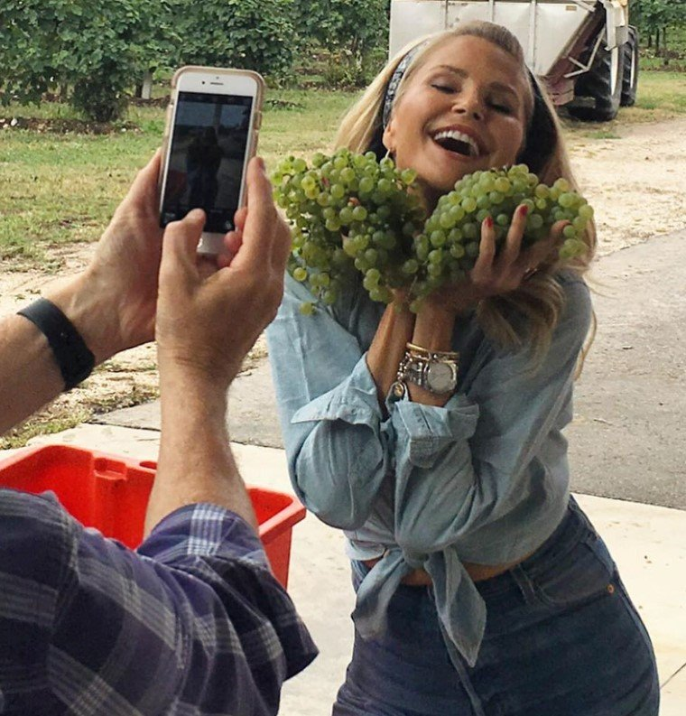 christie brinkley posing with grapes