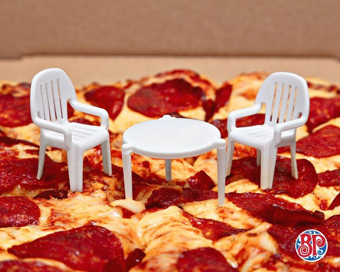 pizza company adds little chairs to little pizza table