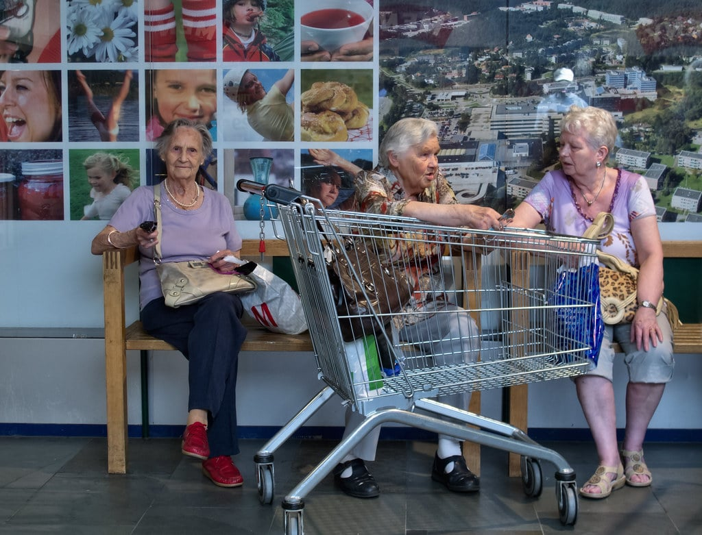 seniors with shopping cart