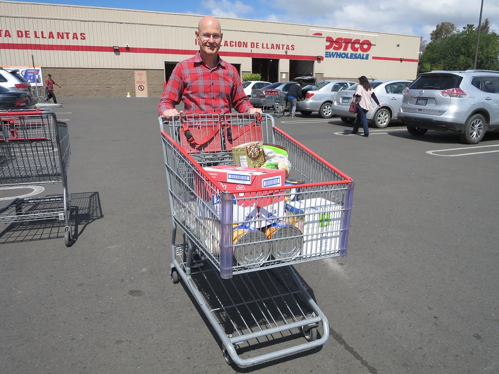 person leaving costco with cart