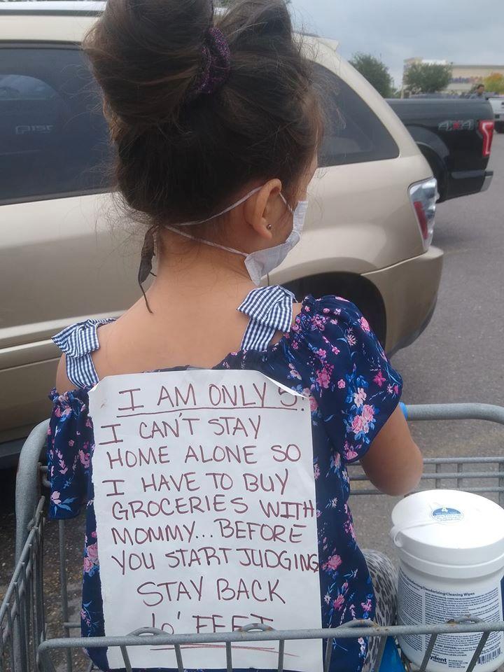 sign on daughters back coronavirus