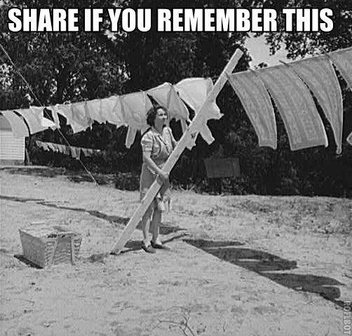 nostalgic photo of person putting clothes on clothespins