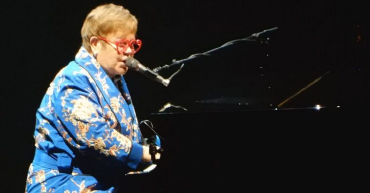 Elton John lays off bandmates and other staff after postponing tour