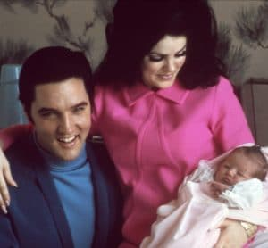 Elvis and Priscilla Presley both have vivid expressions in this picture