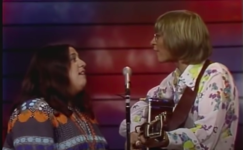 "John Denver and Mama Cass Elliot sing ""Leaving On a Jet Plane"" together"