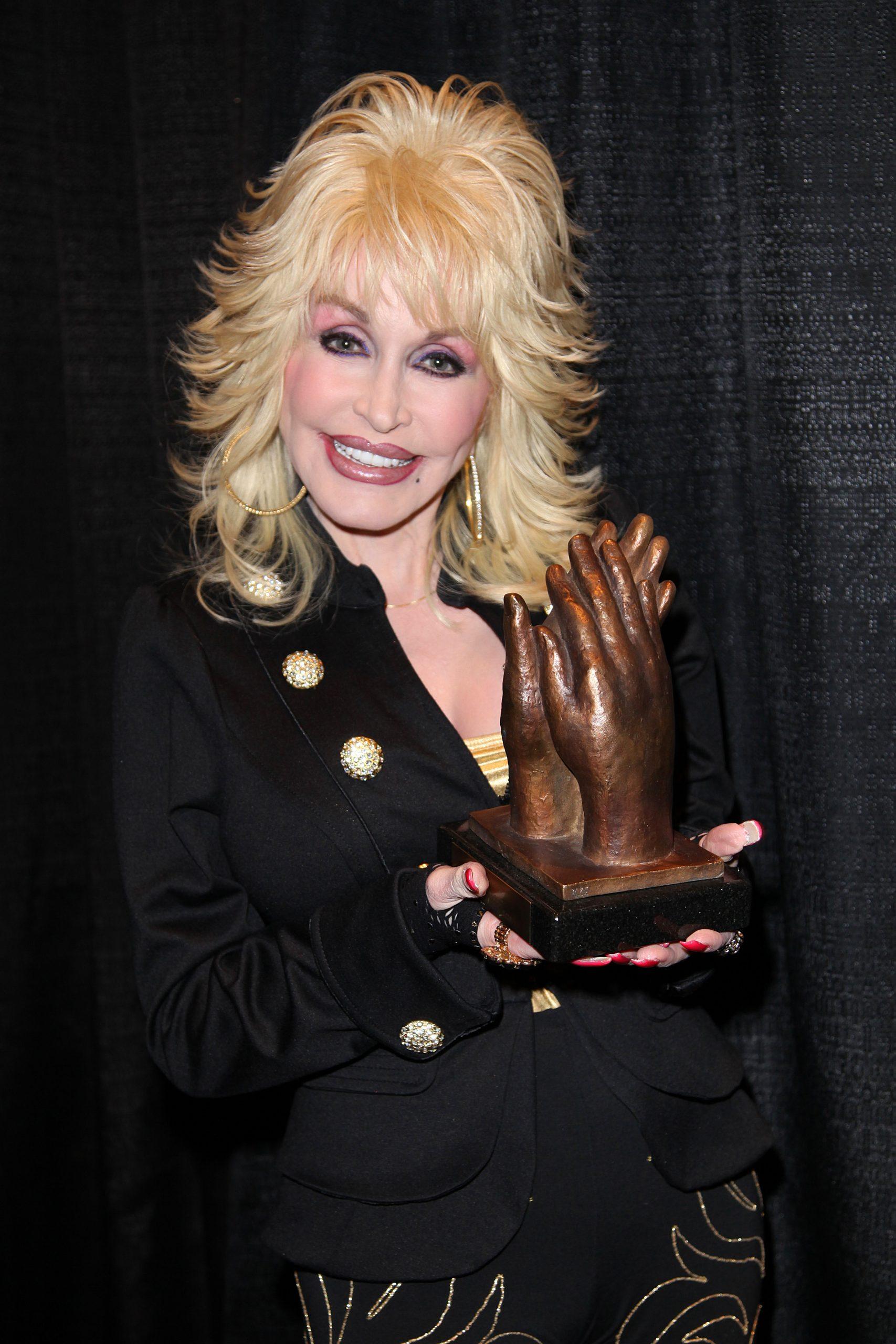 dolly parton with an award