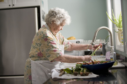 grandmother washing vegetables