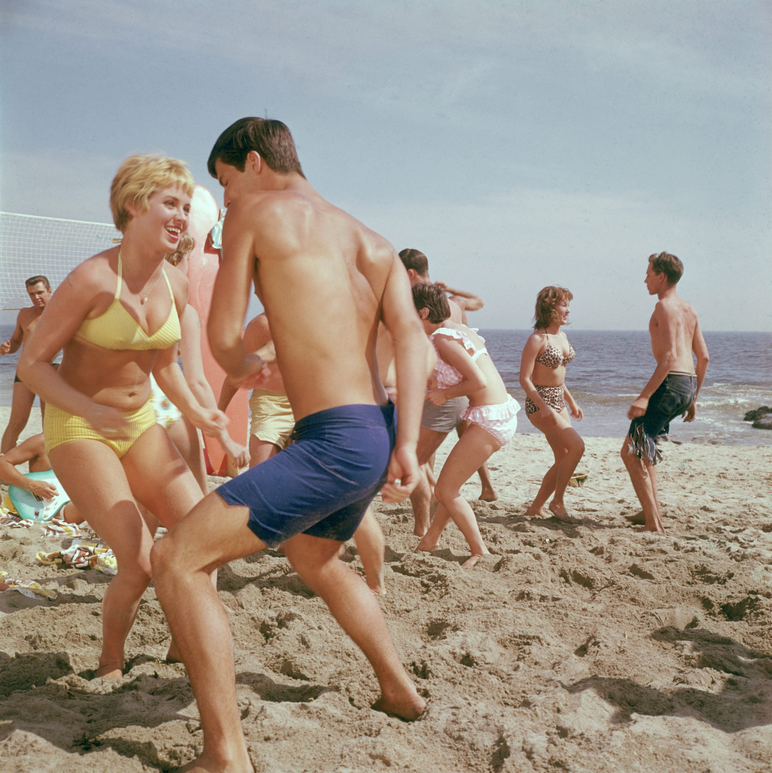 people dancing on a beach 1960s