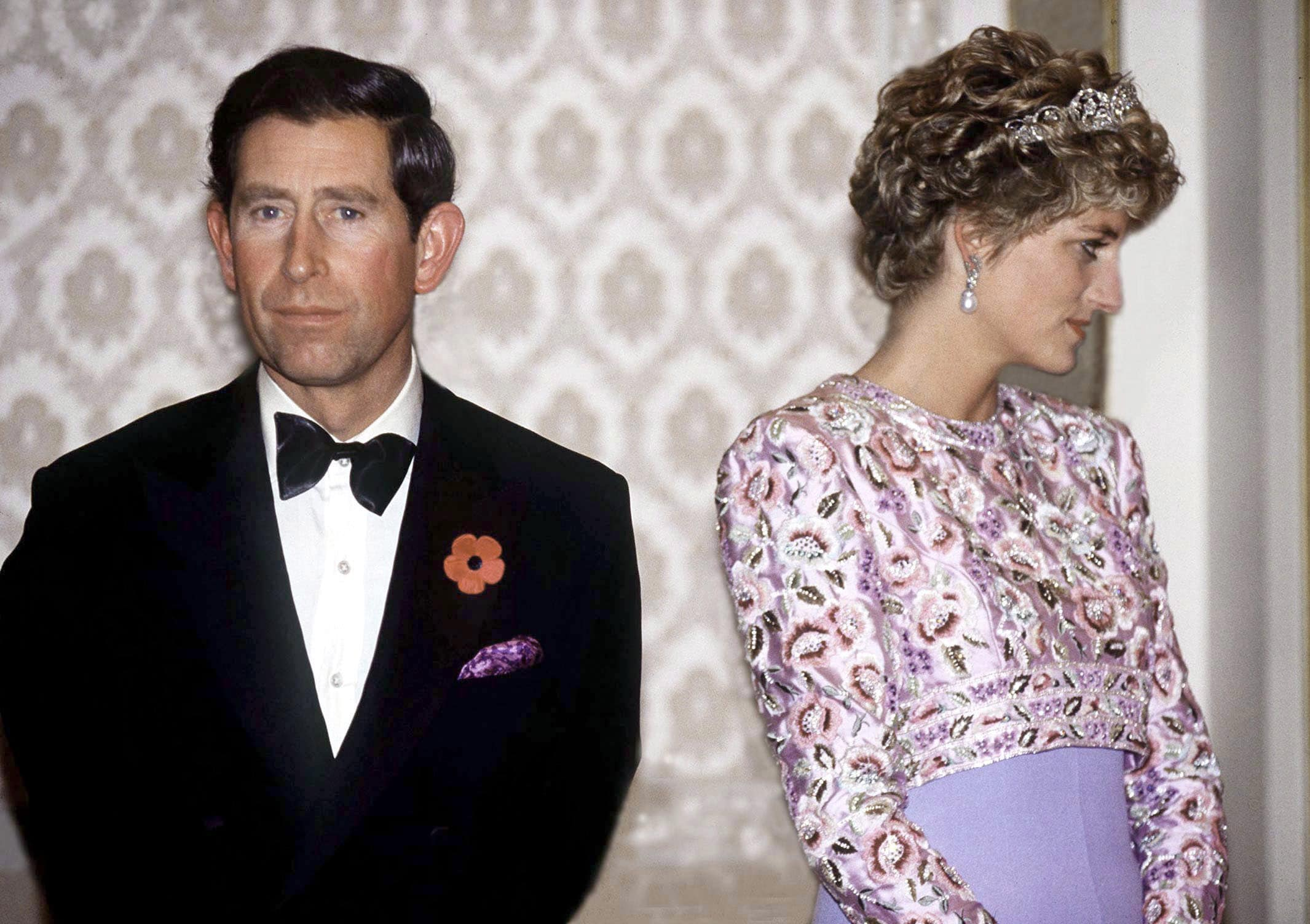 prince charles and princess diana looking unhappy