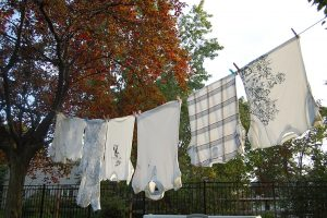 In less dense areas, clotheslines could be two poles, a rope, and possibly some clips