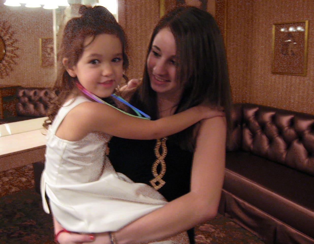 little girl and babysitter
