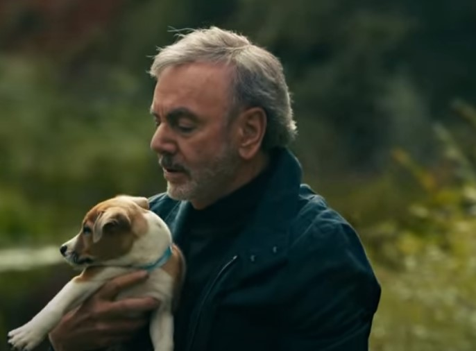 neil diamond and a puppy in his music video