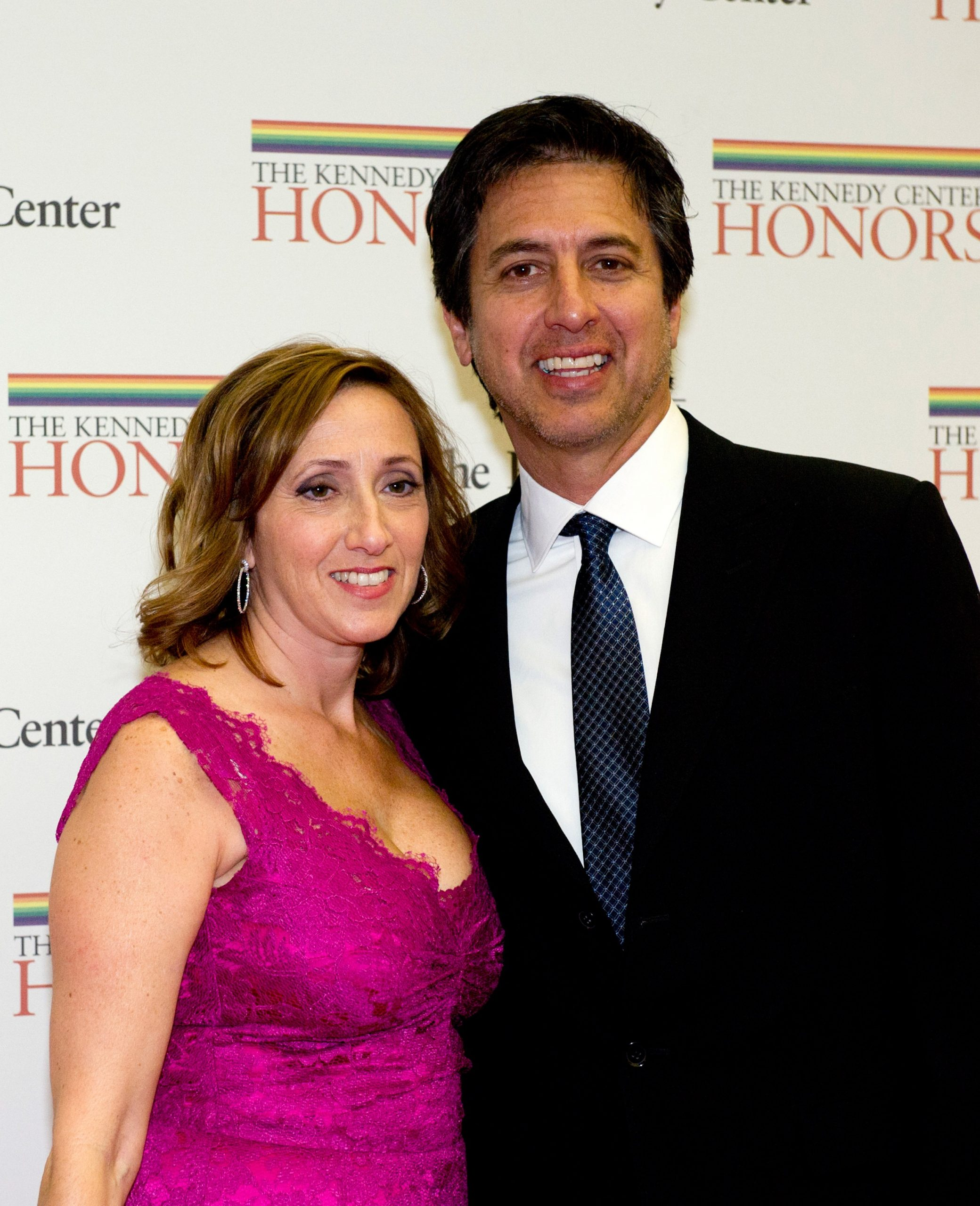 ray romano and his wife anna on a red carpet