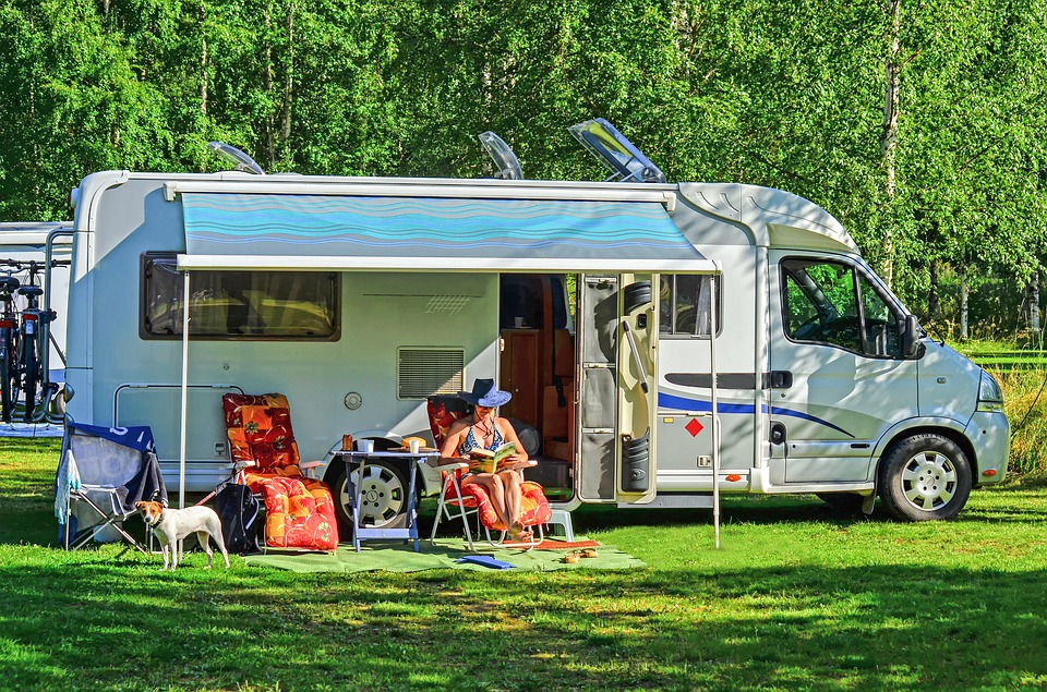 person sitting outside rv