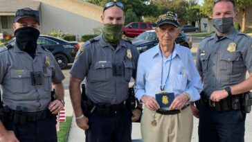 police officers help veteran celebrate 100th birthday