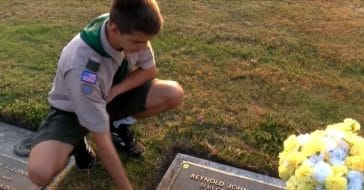 Andrew Baker cleans veterans' graves