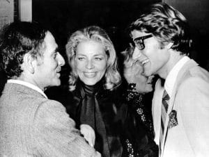 Pierre Cardin attends a party with Lauren Bacall and Yves St. Laurent after starting his empire