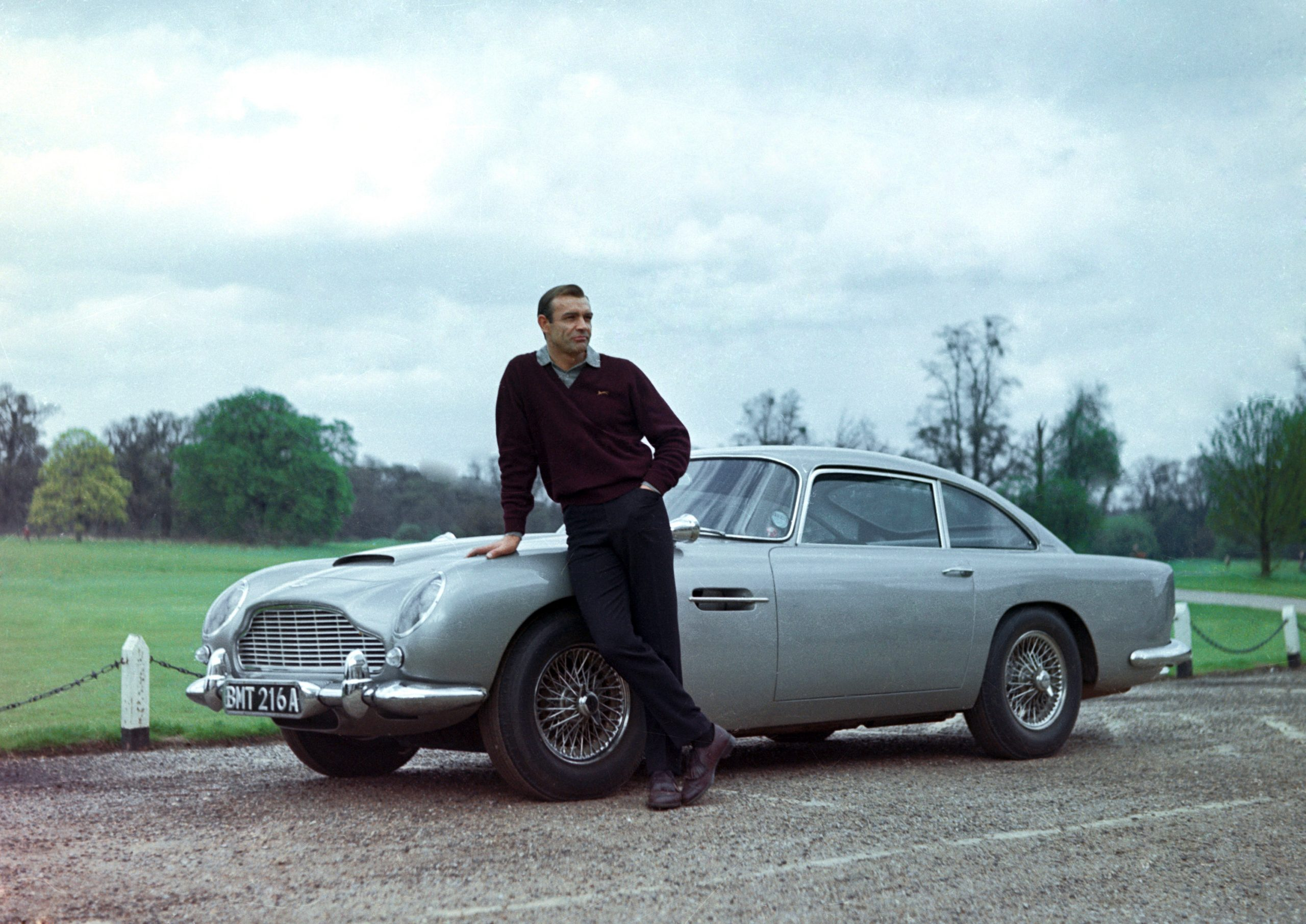 Sean Connery in Goldfinger, which introduced the Aston Martin DB5 as a popular Bond car