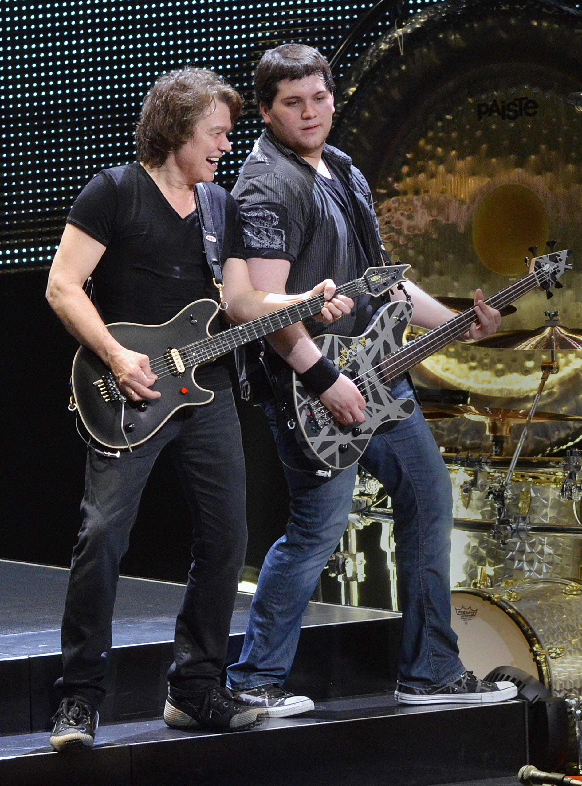 Eddie and Wolfgang Van Halen performing